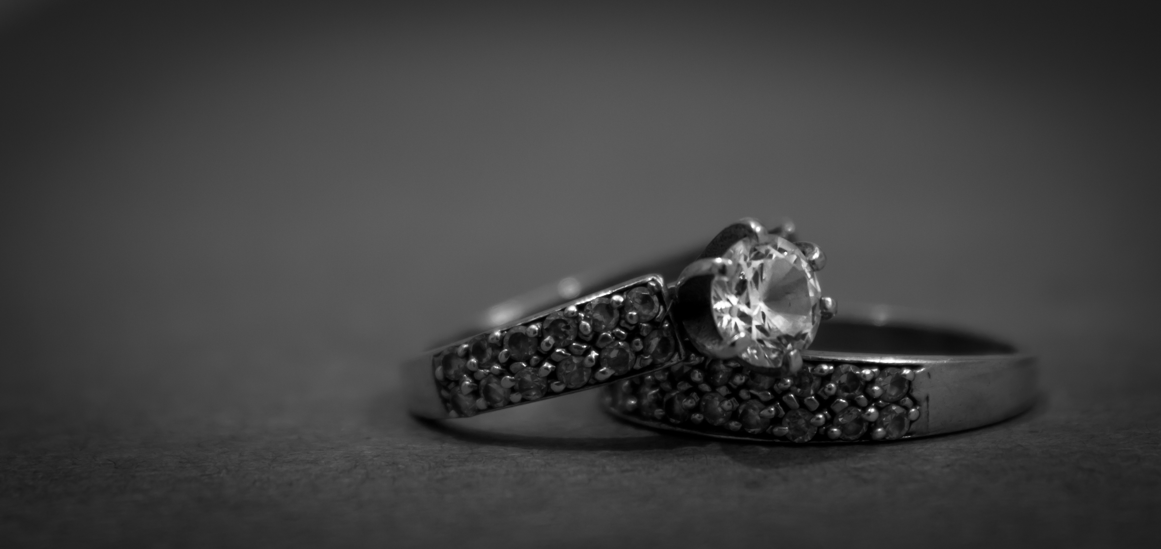 33196 grayscale photo of 2 silver with diamond rings